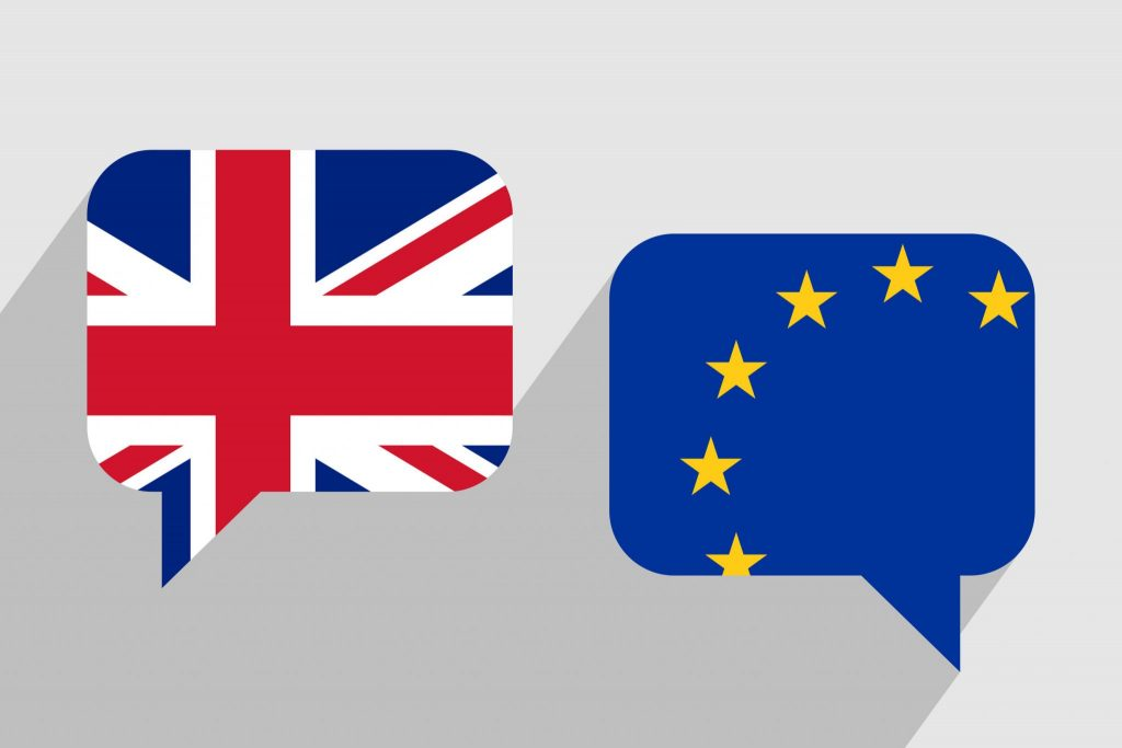60584963 - two message clouds with flags of united kingdom and european union respectively. dialogue between uk and eu. geopolitics and brexit concept